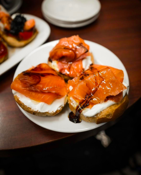 They're called montaditos, which are tapa-sized sandwiches topped with anything from smoked salmon and goat cheese to chorizo and manchego. And the best part is they're small enough to try one of each.